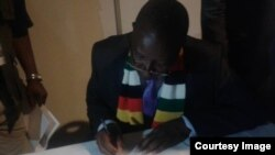 Justice Minister Ziyambi Ziyambi signing documents to acknowledge authenticity of presidential results.
