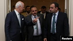 FILE - U.N. special envoy for Syria Staffan de Mistura and Ahmed Beri, chief of staff of the Free Syrian Army, attend the round on Syria peace talks in Astana, Kazakhstan, July 5, 2017.