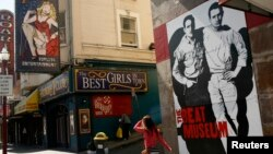 FILE - The figures of author Jack Kerouac (L) and Neal Cassady are painted on the wall of the Beat Museum in the North Beach neighborhood in San Francisco, California, May 27, 2012.