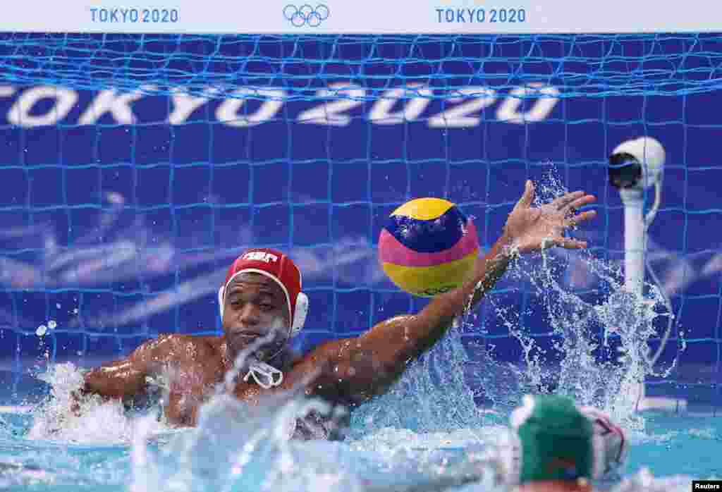Lwazi Madi of South Africa in action. REUTERS/Gonzalo Fuentes
