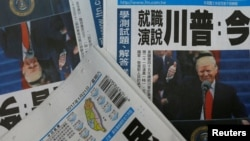 FILE - Copies of the Taiwanese daily newspaper Liberty Times, with its front page featuring the inauguration of Donald Trump as U.S. president, are seen at a printing house in Taipei, Taiwan, Jan. 21, 2017. For the past year, the U.S. has been boosting its ties with the island, despite recognizing it as part of China.