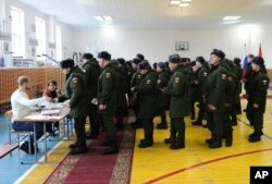 FILE - Russian soldiers line up to get their ballots in the presidential election in Rostov-ojn-Don, Russia, March 18, 2018.