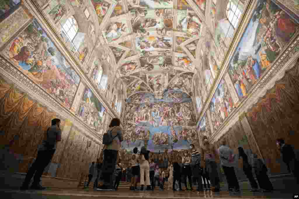 Visitors admire the Sistine Chapel as the Vatican Museum reopened, in Rome, Italy.
