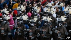 People watch the city's first Day of the Dead parade on Reforma Avenue in Mexico City, Oct. 29, 2016.