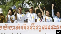 Cambodian non-governmental organizations workers shout slogans during a demonstration in Phnom Penh, Cambodia, 2004. Local aid workers marched through Phnom Penh to urge the donors to press Cambodia to remove restrictions on demonstrations, promote rule o