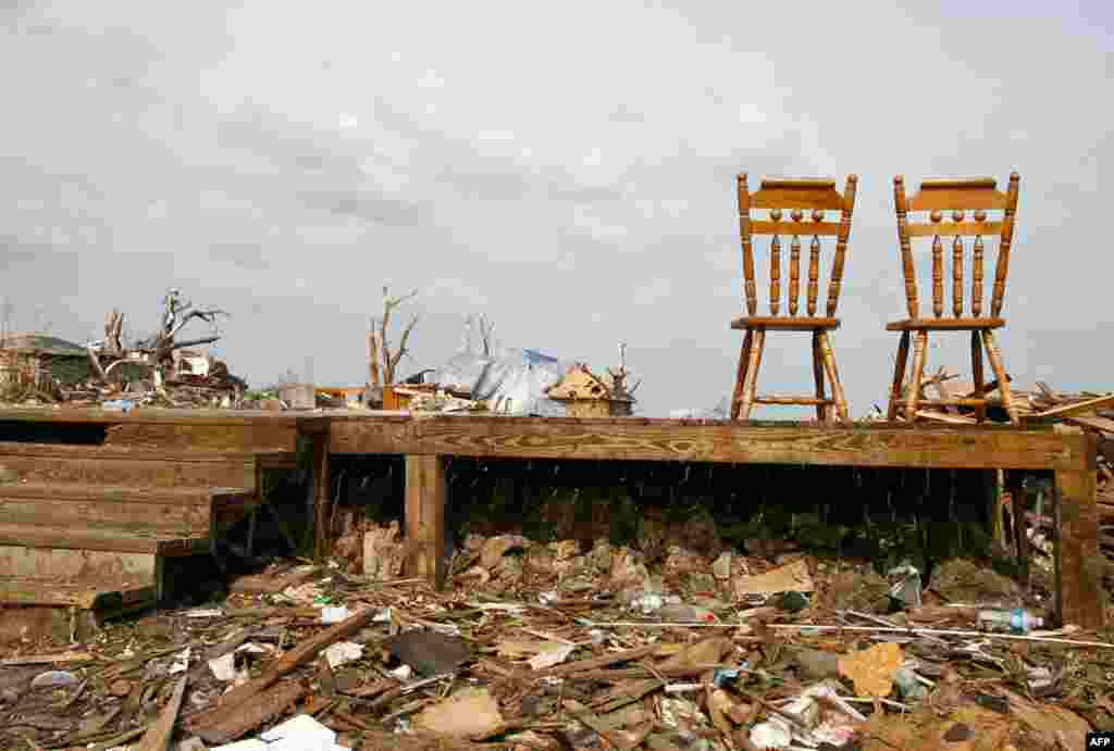 June 1: Two kitchen chairs are all that is left in a destroyed house following the May 22 tornado in Joplin, Missouri. (REUTERS/Sarah Conard)
