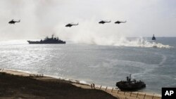 Russian navy ships and helicopters take a part in a landing operation during military drills at Crimea's Black Sea coast, Sept. 9, 2016. Russia annexed the peninsula from Ukraine in March 2014.