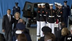 President Barack Obama and Secretary of State Hillary Rodham Clinton walk back to their seats after speaking during the Transfer of Remains Ceremony at Andrews Air Force Base in Maryland, September 14, 2012.
