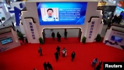 FILE - China's President Xi Jinping is shown on a screen during the fourth World Internet Conference in Wuzhen, Zhejiang province, China, December 4, 2017.