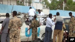 This image made from video shows the scene following a bomb attack on a van carrying U.N. employees in Garowe, in the semi-autonomous Puntland region of northern Somalia, April 20, 2015.