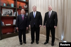 U.S. Secretary of State Mike Pompeo poses with Vice Chairman of the North Korean Workers' Party Committee Kim Yong Chol, North Korea's lead negotiator in nuclear diplomacy with the United States, and U.S. Special Representative for North Korea Stephen Biegun as they start talks aimed at clearing the way for a second U.S.-North Korea summit at a hotel in Washington, Jan. 18, 2019.