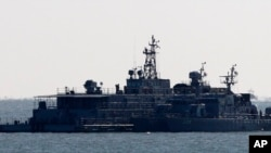 FILE - South Korea's navy ships are anchored near the Yeonpyeong Island, South Korea.