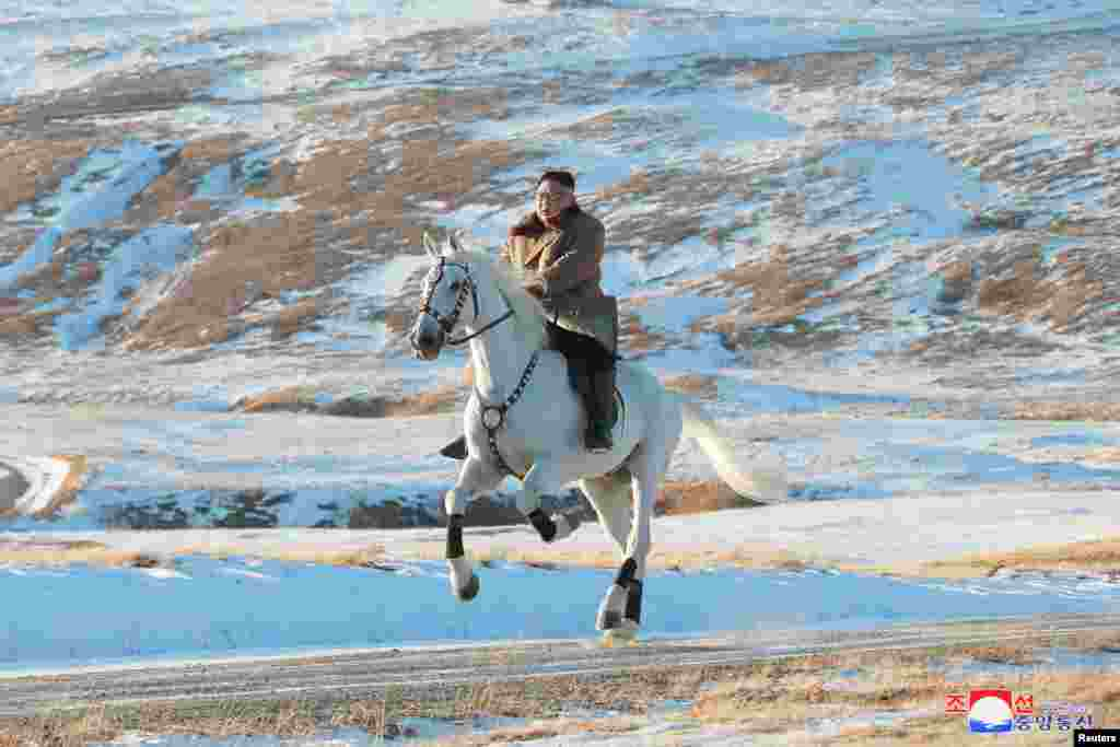 North Korean leader Kim Jong Un rides a horse during snowfall in Mount Paektu in this image released by North Korea's Korean Central News Agency (KCNA).