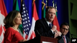 FILE - U.S. Trade Representative Robert Lighthizer, center, with Canadian Minister of Foreign Affairs Chrystia Freeland, left, and Mexico's Secretary of Economy Ildefonso Guajardo, right, speaks during the conclusion of the fourth round of NAFTA negotiations in Washington, Oct. 17, 2017.