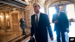 FILE - Special counsel Robert Mueller departs after a closed-door meeting with members of the Senate Judiciary Committee about Russian meddling in the election and possible connection to the Trump campaign, at the Capitol in Washington, June 21, 2017.