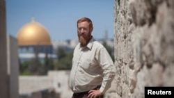 """FILE - Yehuda Glick, an activist of the """"temple mount faithful"""" group, was shot and severely wounded in Jerusalem, Oct. 29, 2014."""