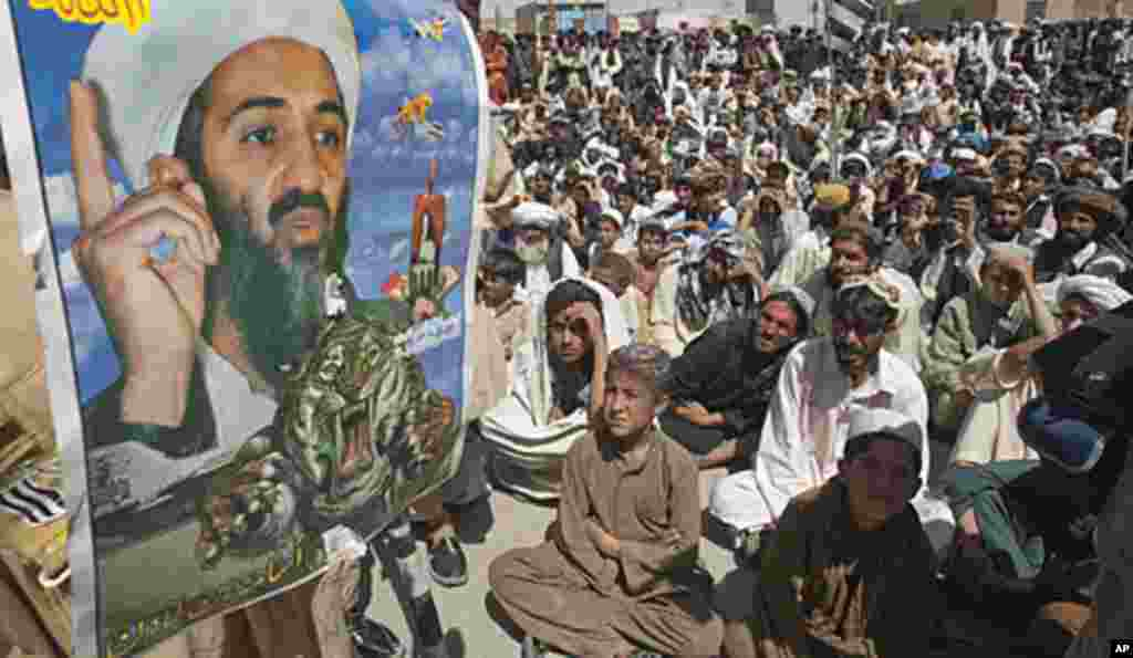 Supporters of Pakistani religious party Jamiat-e-ulema-e-Islam are seen near an image of al-Qaeda leader Osama bin Laden during an anti-U.S. rally on the outskirts of Quetta May 6, 2011 (Reuters).