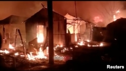 A general view during a fire outbreak in Rohingya refugee camp, in Cox's Bazar, Bangladesh January 14, 2021 in this still image obtained from a video. (Mohammed Arakani/Handout via REUTERS)