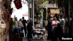 People shop in a shopping district in Hatay, Turkey, May 17, 2013.