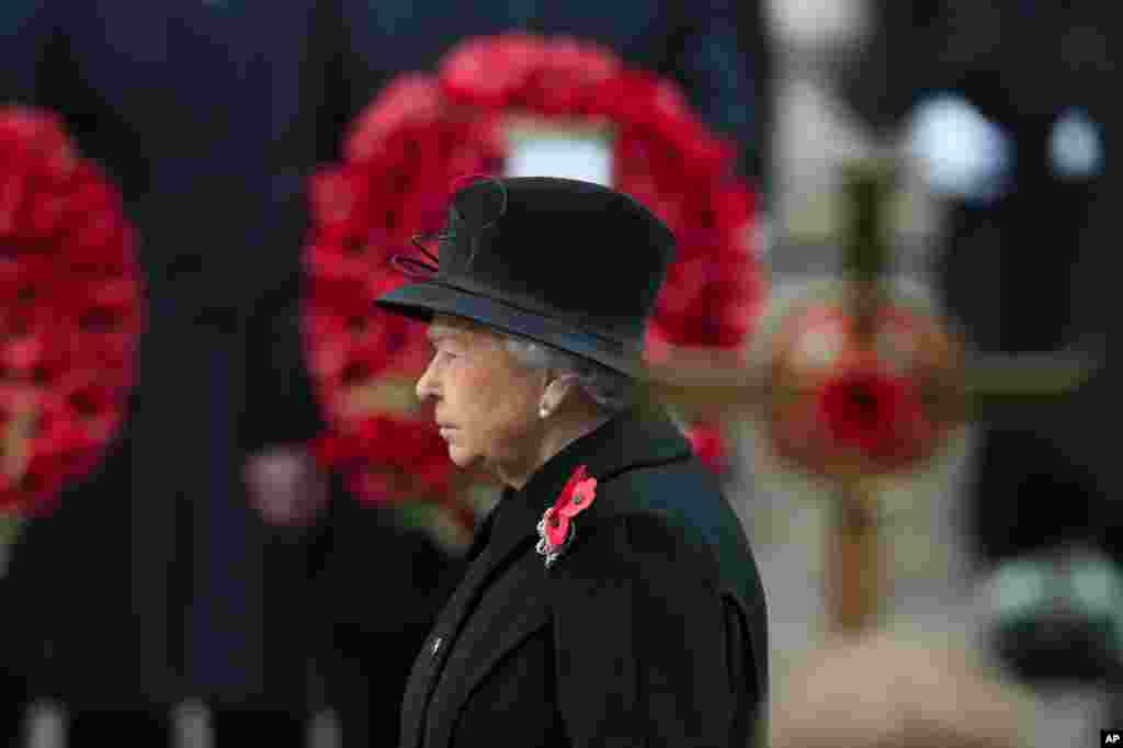Britain's Queen Elizabeth II listens during the service of remembrance at the Cenotaph in Whitehall, London. The annual service is to remember those who have lost their lives serving in the Armed Forces.