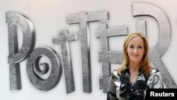 British author JK Rowling poses during the launch of new online website Pottermore in London.