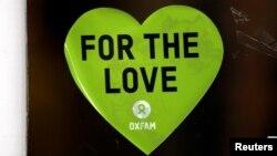 A sticker is seen in the window of a branch of Oxfam, in London, Britain, Feb. 12, 2018.