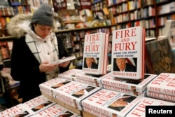 Copies of the book Fire and Fury: Inside the Trump White House by author Michael Wolff are seen at the Book Culture bookstore in New York, Jan. 5, 2018.