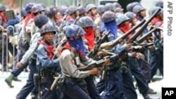 Burmese military address a protest in this file photo from 2007. The government continues to crack down on dissent, according to the U.S. Department of State.