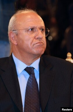 Former Lebanese PM Michel Samaha attends a funeral in Beirut, March 21, 2005.