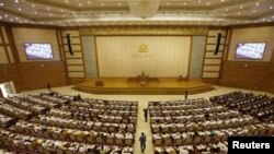 Members of parliament attend the opening of the Lower House session in Naypyitaw.