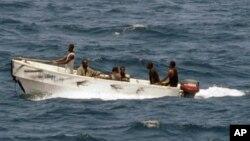 In this U.S. Navy photo, pirates leave the Ukrainian merchant vessel MV Faina for Somalia's shore Wednesday, Oct. 8, 2008.