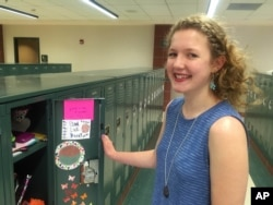 High school student Dana Craig, 15, stands at her locker in River Falls, Wisconsin, May 31, 2016.