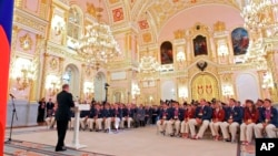 FILE - In this file photo taken on Tuesday, Sept. 11, 2012, President Vladimir Putin, foreground left, speaks as he meets with the national paralympic team after they returned from the Paralympic Games 2012 in London, in Moscow's Kremlin, Russia. The entire Russia team has been banned from competing in the Paralympic Games in September as punishment for the country's systematic doping program.
