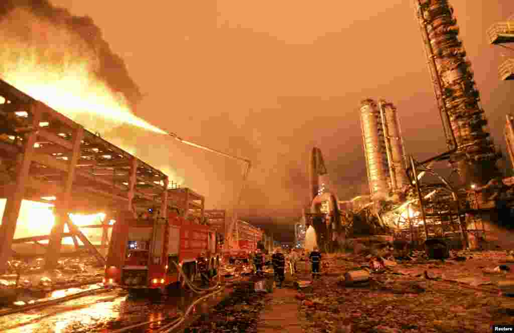 Firefighters try to extinguish a fire at a petrochemical plant in Zhangzhou, Fujian province, China. At least six people were injured after an explosion hit part of an oil storage facility at Dragon Aromatics, an independent petrochemical producer in eastern China, Xinhua reported.
