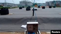 A leakage detective unit (C) and its detection punch unit on an underground water storage tank are seen at TEPCO's tsunami-crippled Fukushima nuclear power plant in Fukushima, in this undated photograph released by TEPCO on April 6, 2013.
