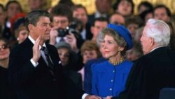 Ronald Reagan is sworn in for a second term in January 1985, as Nancy Reagan watches