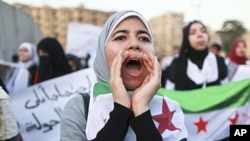 Women take part in a demonstration against Syria's President Bashar al-Assad. (file)