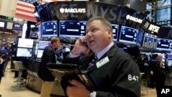 Trader George Ettinger works on the floor of the New York Stock Exchange, Nov. 13, 2015.