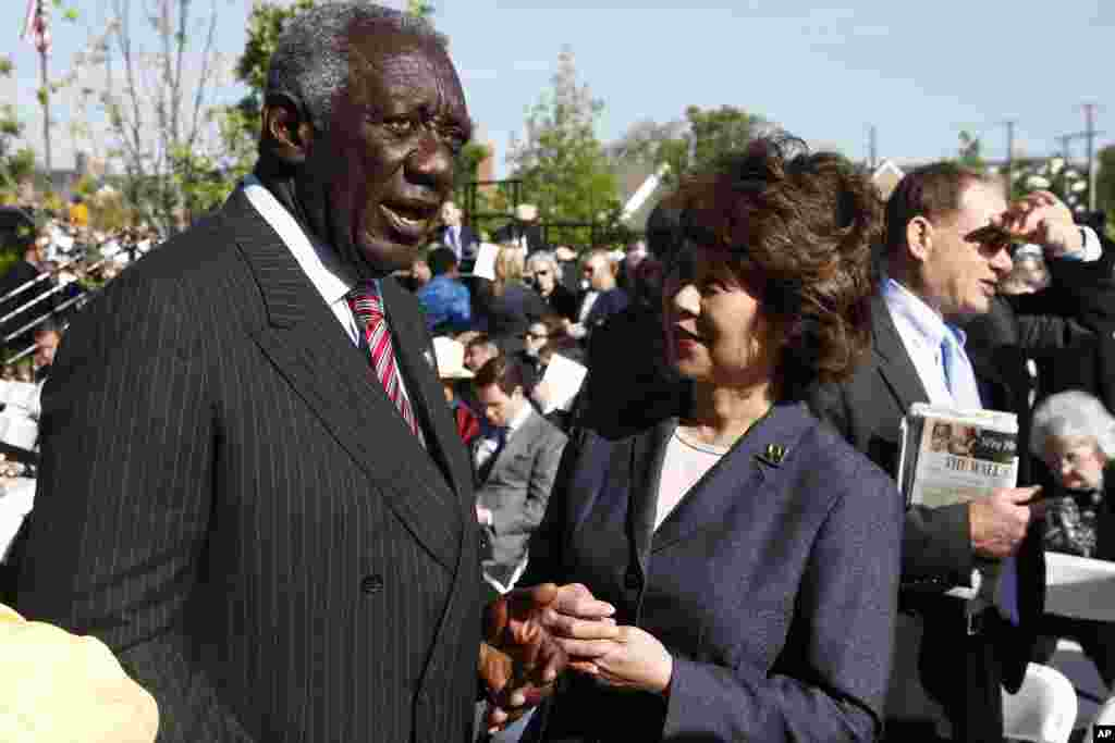 Former Ghana President John Kufuor speaks with former Labor Secretary Elaine Chao at the dedication of the George W. Bush Presidential Center, Dallas, Texas, April 25, 2013.