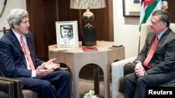 U.S. Secretary of State John Kerry meets with Jordan's King Abdullah (R) at Al-Hummar Palace in Amman, Jan. 5, 2014.