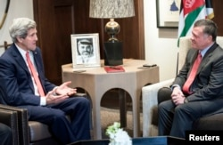 FILE - U.S. Secretary of State John Kerry, left, meets with Jordan's King Abdullah at Al-Hummar Palace in Amman Jan. 5, 2014.