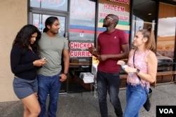Left to right: Friends Hinna Akhtar, Abdulla Kudrath, Shannon Washington and Samantha Graiza share an Indian and Pakistani meal at Himalaya Restaurant in Houston, Texas. (R. Taylor/VOA News)