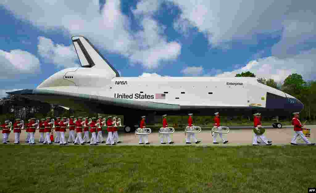 Space shuttle Enterprise is seen as the United States Marine Corp Drum and Bugle Corps and Color Guard march by at the Steven F. Udvar-Hazy Center in Chantilly. Enterprise will be transferred to the Intrepid Sea, Air and Space Museum in New York City. (NA