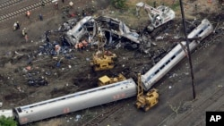 Emergency personnel work at the scene of a deadly Amtrak train derailment in Philadelphia, May 13, 2015.