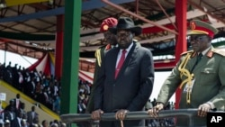 FILE - South Sudan's President Salva Kiir, center, accompanied by then-Army Chief of Staff Paul Malong, right, attends an independence day ceremony in the capital, Juba, July 9, 2015.