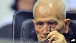 FILE - In this photo released by the Extraordinary Chambers in the Courts of Cambodia, Nuon Chea, who was the Khmer Rouge's chief ideologist and No. 2 leader, sits in a courtroom before a hearing at the U.N.-backed war crimes tribunal in Phnom Penh.