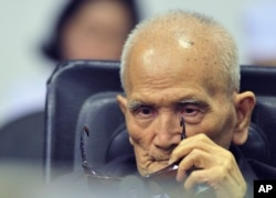 In this photo released by the Extraordinary Chambers in the Courts of Cambodia, Nuon Chea, who was the Khmer Rouge's chief ideologist and No. 2 leader, sits in a courtroom before a hearing at the U.N.-backed war crimes tribunal in Phnom Penh, Cambodia, Nov. 16, 2018.