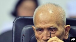 In this photo released by the Extraordinary Chambers in the Courts of Cambodia, Nuon Chea, who was the Khmer Rouge's chief ideologist and No. 2 leader, sits in a courtroom before a hearing at the U.N.-backed war crimes tribunal in Phnom Penh, Cambodia, No