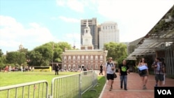 People walk along the Independence Hall, the historic place in Philadelphia, Pennsylvania. July, 27 2016.