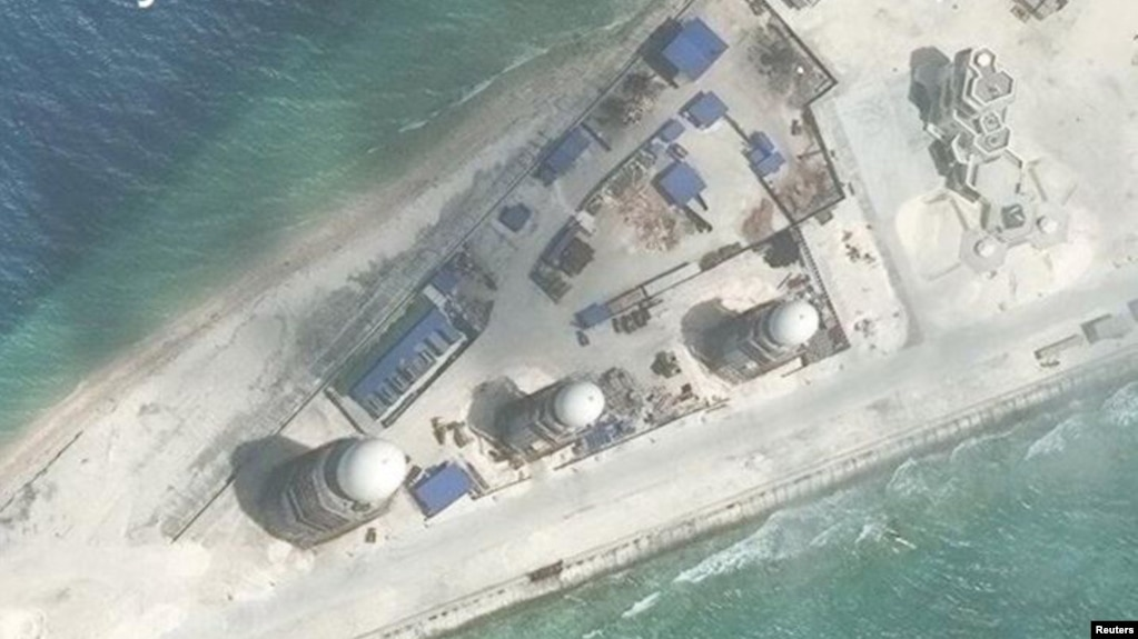 FILE - Construction is shown on Fiery Cross Reef, in the Spratly Islands, the disputed South China Sea in this March 9, 2017, satellite image released by CSIS Asia Maritime Transparency Initiative at the Center for Strategic and International Studies (CSIS).